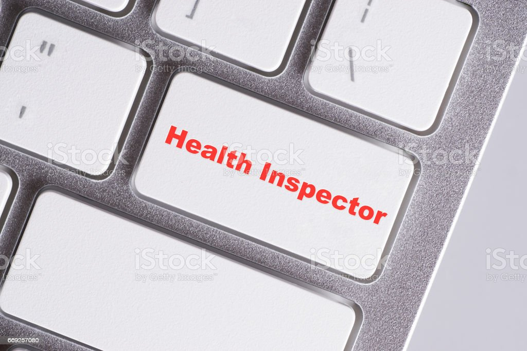 'Health inspector' red words on white keyboard - online, education and business concept stock photo