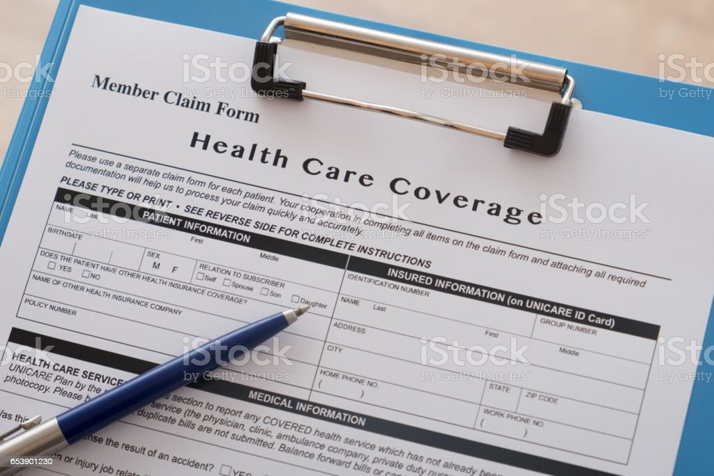 Health insurance claim form and pen stock photo