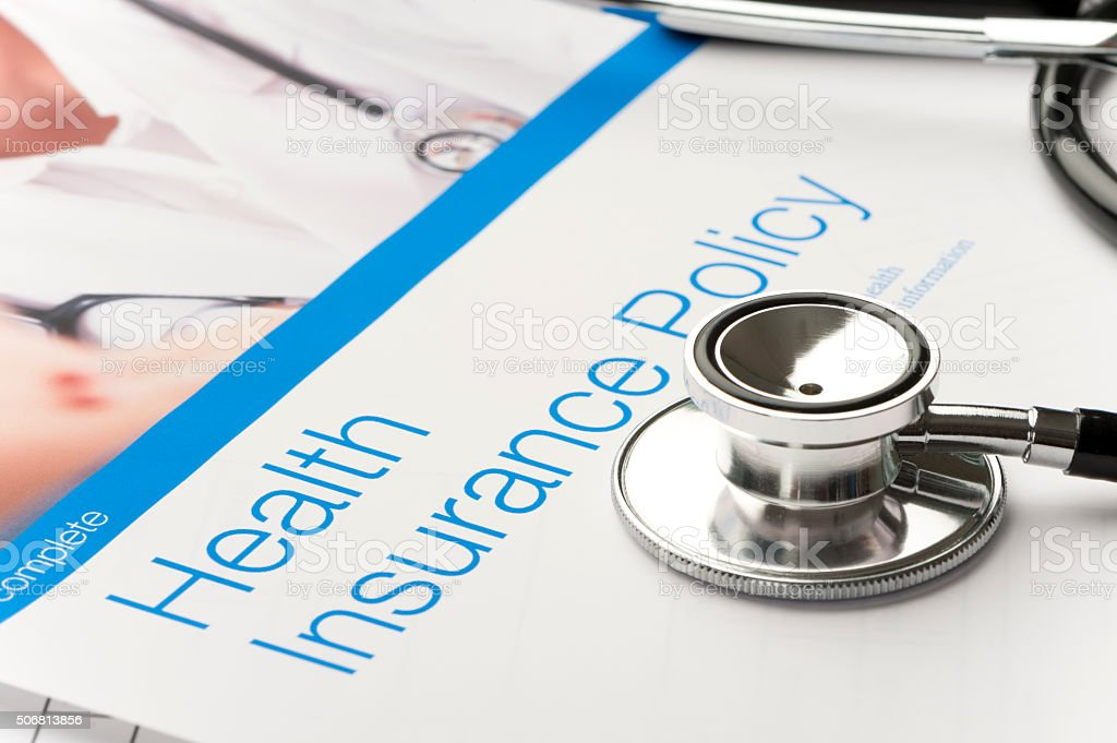 Health Insurance Policy brochure with paperwork. stock photo