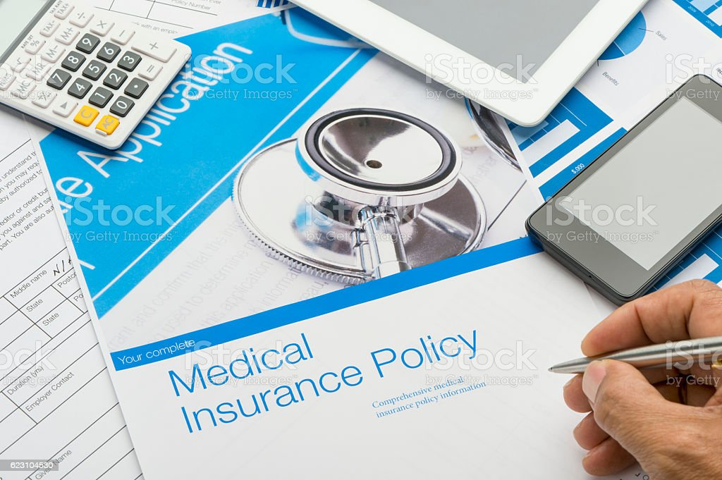 Health Insurance Policy brochure with paperwork stock photo