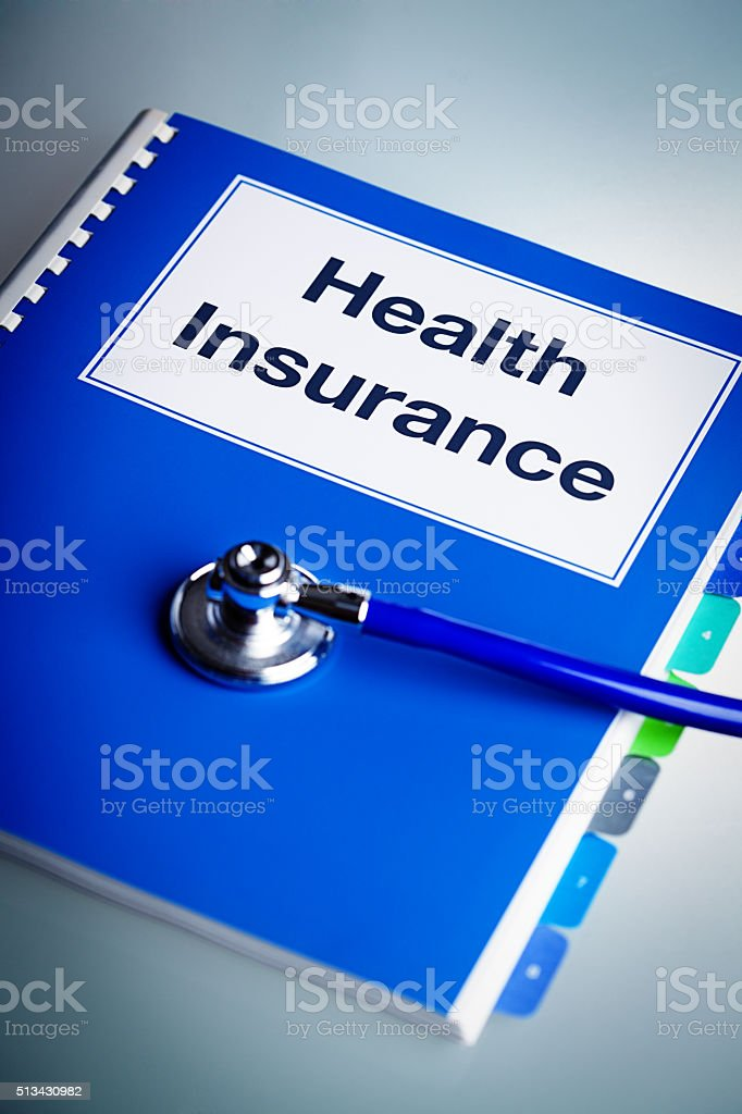 Health Insurance Policy Document with Stethoscope stock photo
