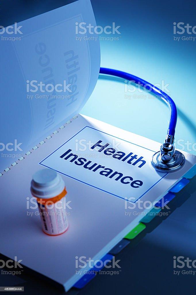 Health Insurance Policy Open Enrollment Handbook with Prescription Drug stock photo