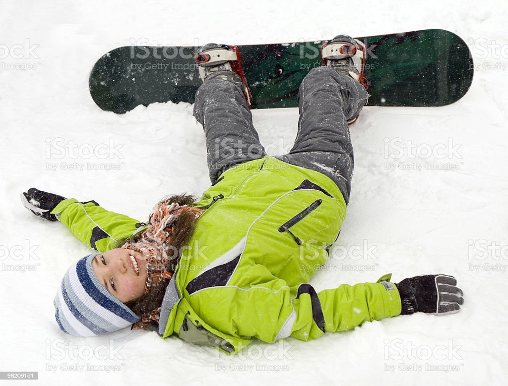 health lifestyle image of young snowboarder girl after incidence stock photo