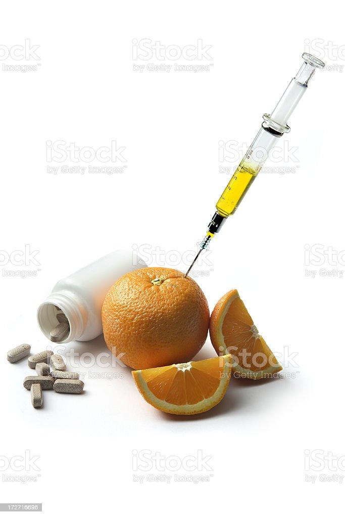 Health: Orange, Syringe and Pills royalty-free stock photo