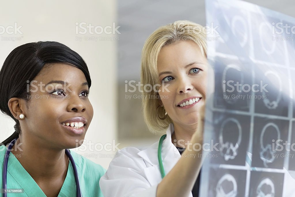 Health Professionals talking about the results of a MRI Scan stock photo