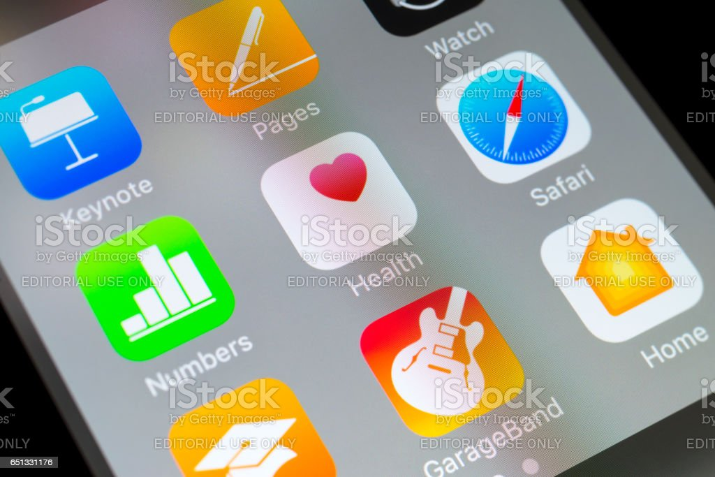 Health, Safari, Numbers and other Apple apps on cellphone stock photo