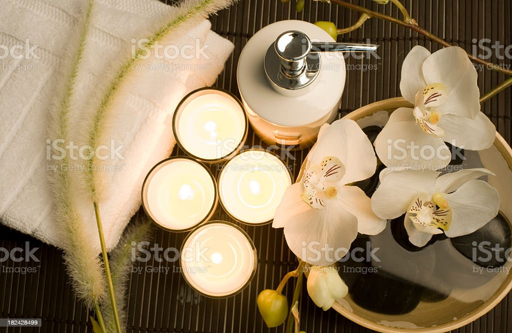 Health spa setting in a zen-like atmosphere with candlelight royalty-free stock photo