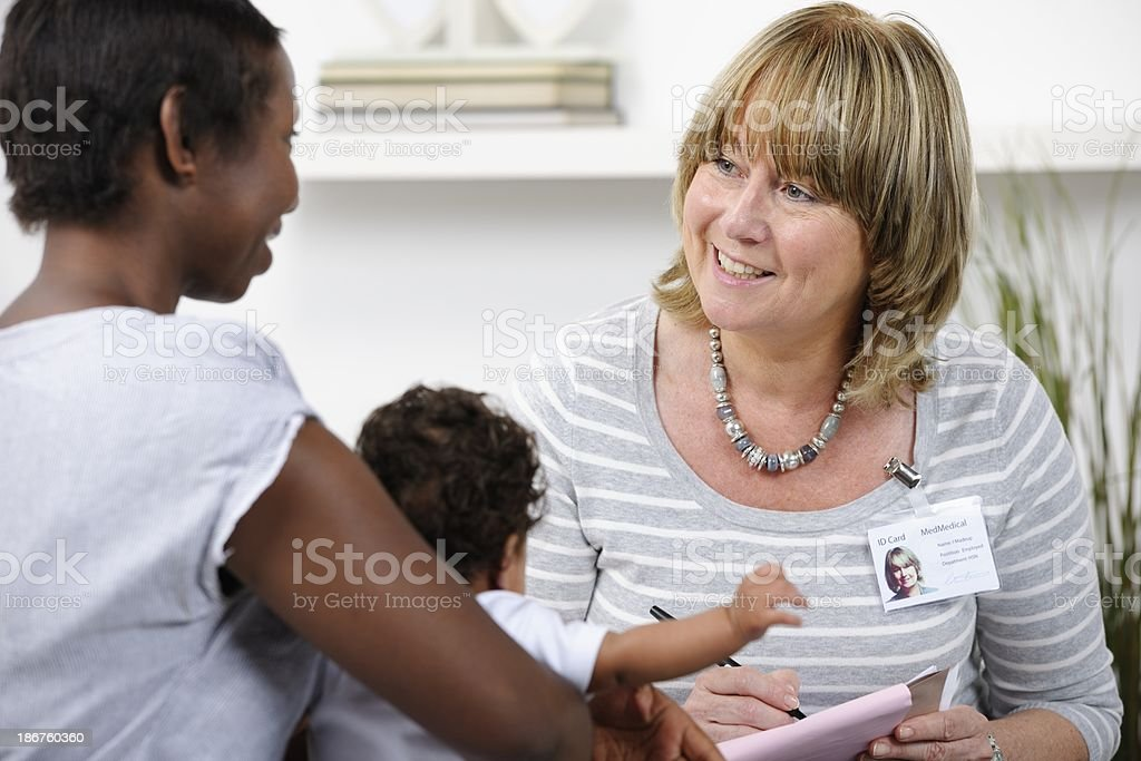 Health Visitor/ Healthcare Worker Giving Advice To A New Mother stock photo