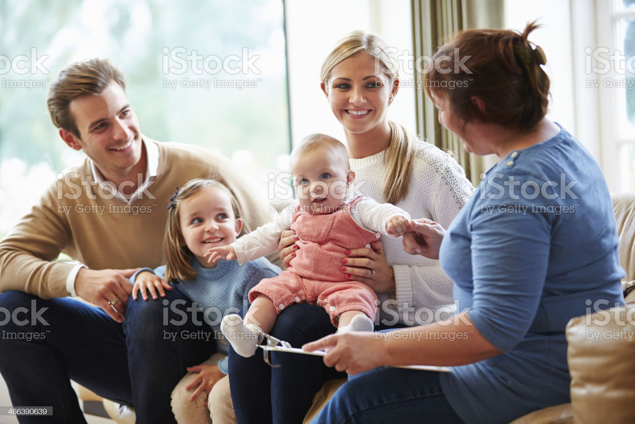 Health Visitor Talking To Family With Young Baby royalty-free stock photo