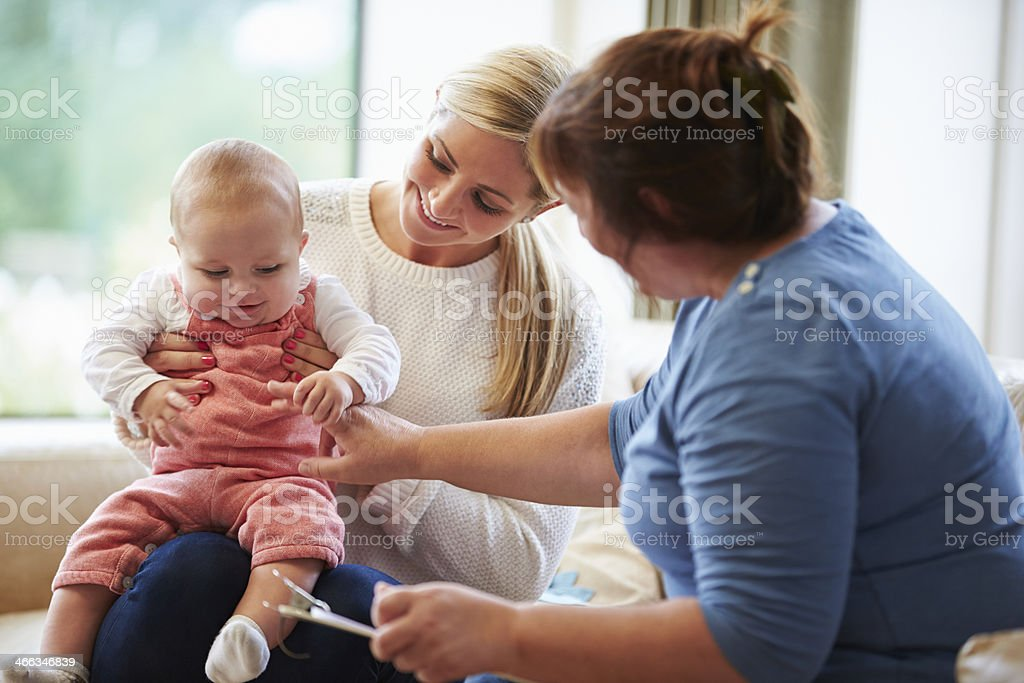 Health Visitor Talking To Mother With Young Baby stock photo