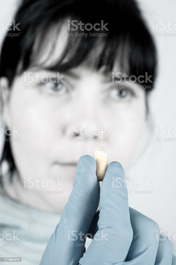 Health worker holds capsule stock photo