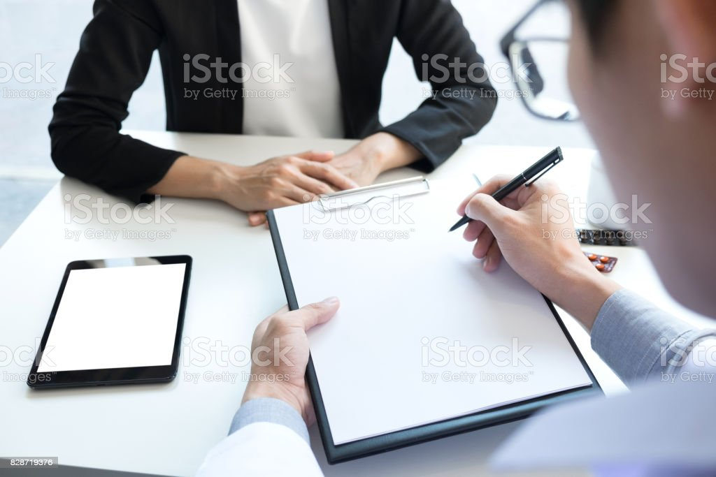 Healthcare and Medical concept, Doctor and patient are discussing something, just hands at the table stock photo