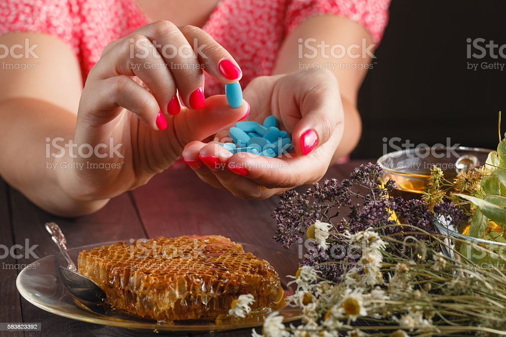 Healthcare and medicine: Young woman has control over pills stock photo