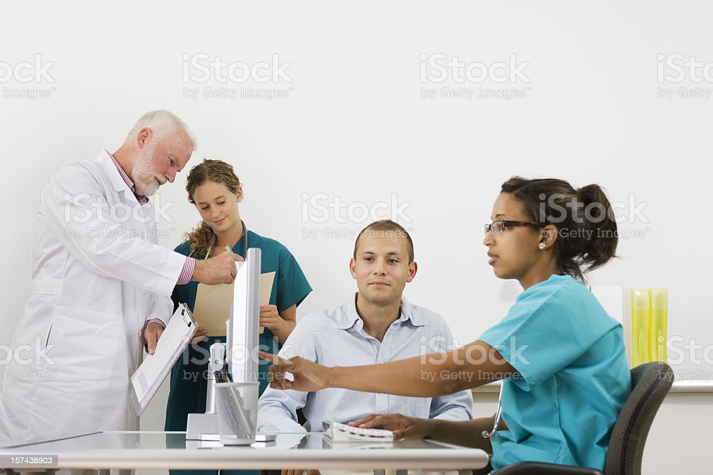 Healthcare and Medicine—Doctor, Nurse, Medical Student, Patient in Clinic royalty-free stock photo