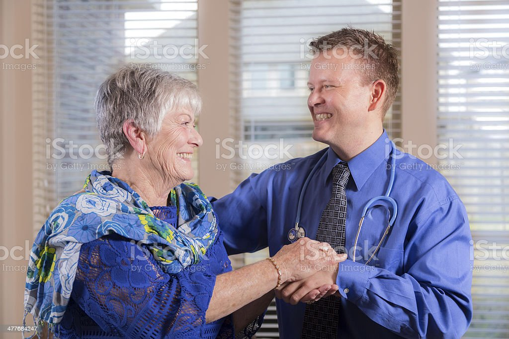 Healthcare: Concierge doctor visits senior woman. House or nursing home. royalty-free stock photo
