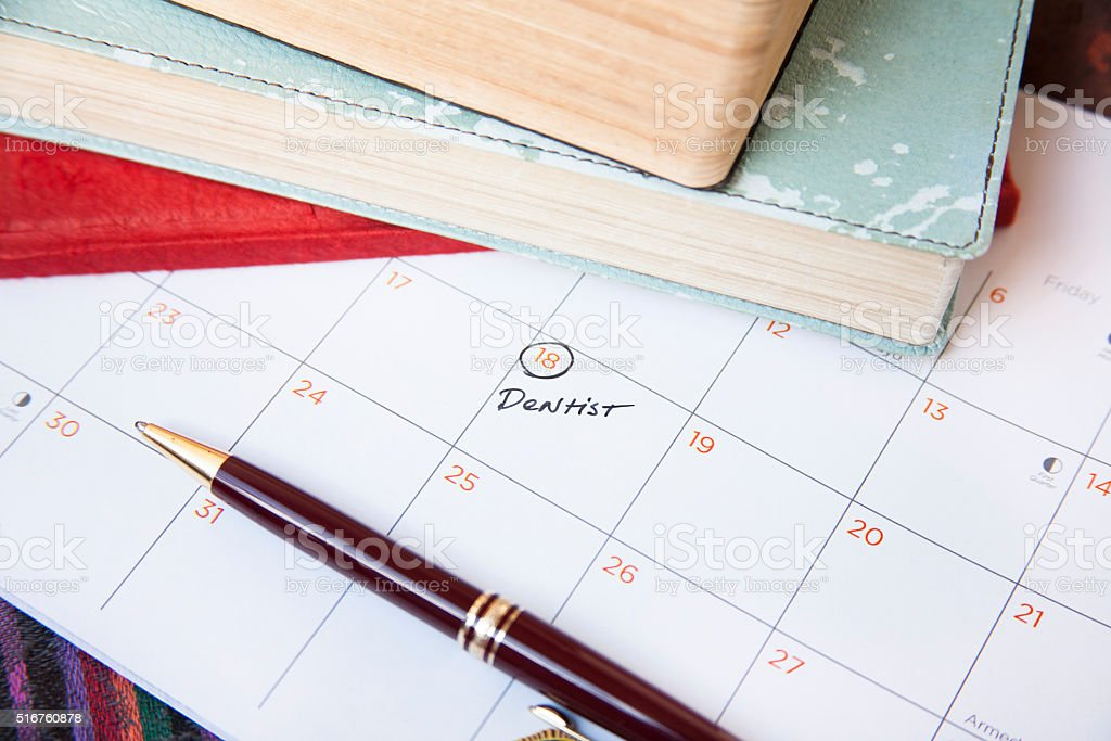 Healthcare: Dentist appointment reminder written on calendar. stock photo