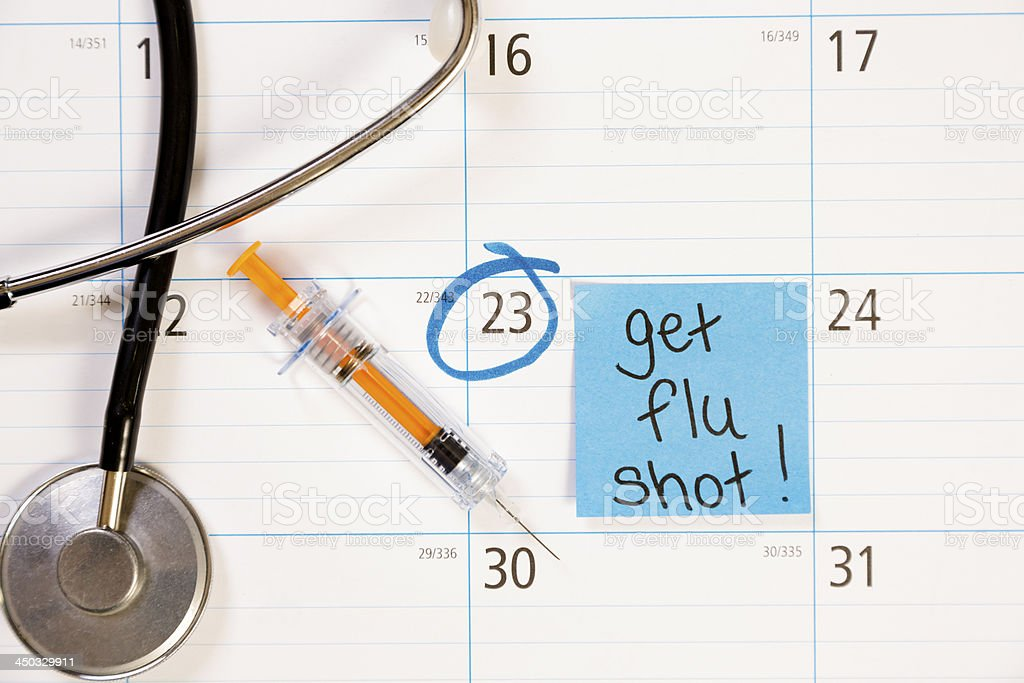 Healthcare: Flu shot reminder note on calendar. royalty-free stock photo