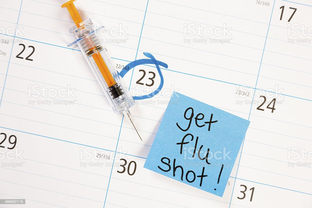 Healthcare: Flu shot reminder note on calendar. stock photo