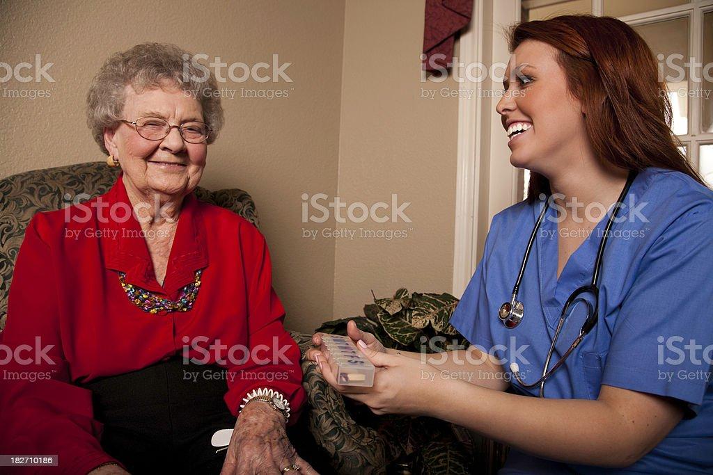 Healthcare Nurse Explaining Medication to Senior Adult Patient royalty-free stock photo