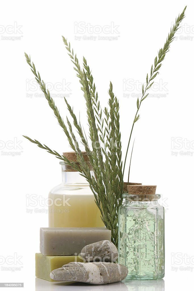 Healthcare products in bottles with cork and grass royalty-free stock photo