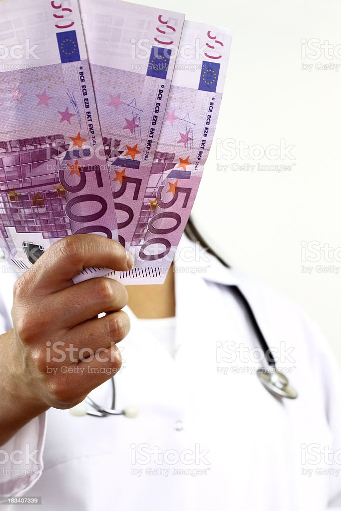 Healthcare professional showing euro currency royalty-free stock photo