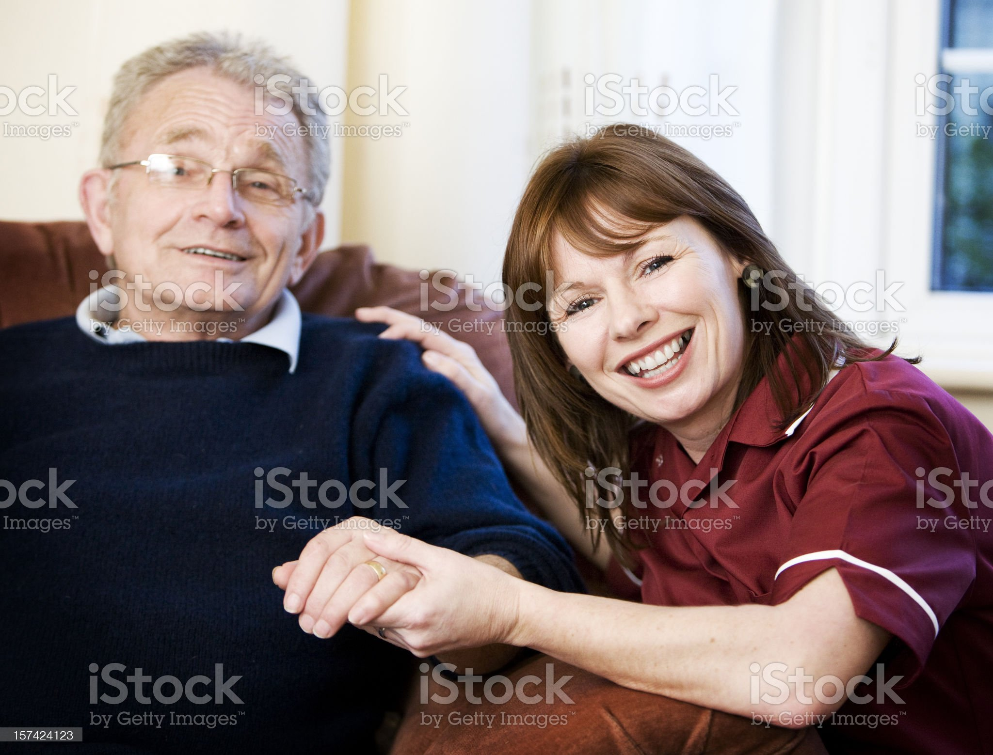 Healthcare: smiles from a care worker and her senior client royalty-free stock photo