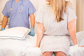 Healthcare: Woman in doctor's office for annual check up.