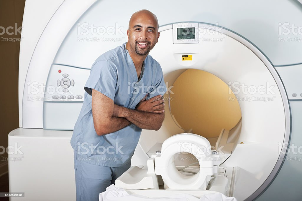 Healthcare worker preparing CT scanner royalty-free stock photo