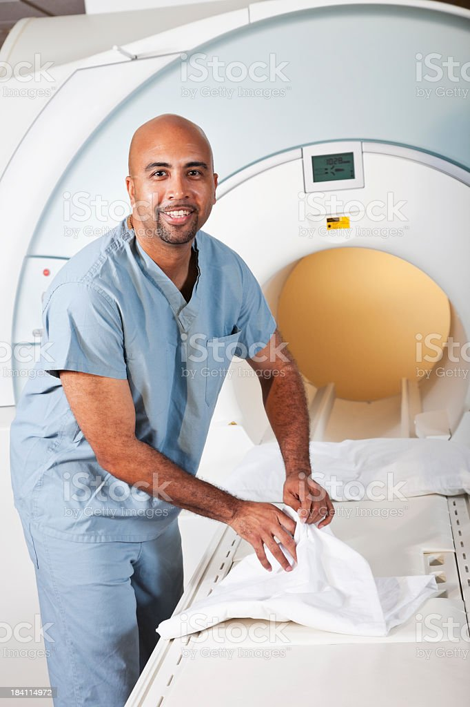 Healthcare worker preparing MRI scanner royalty-free stock photo