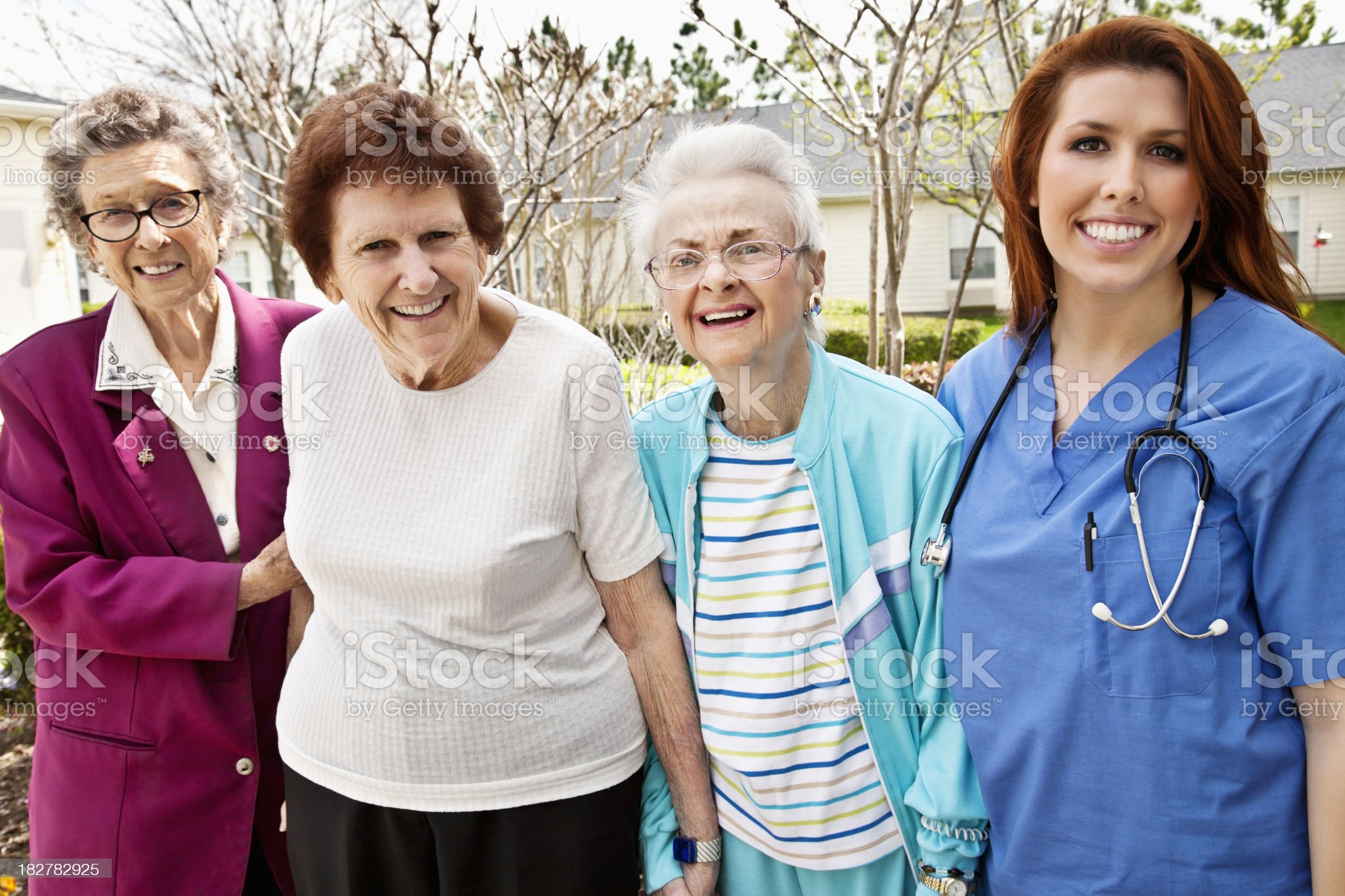 Healthcare Worker with a Happy Group of Senior Adult Women royalty-free stock photo