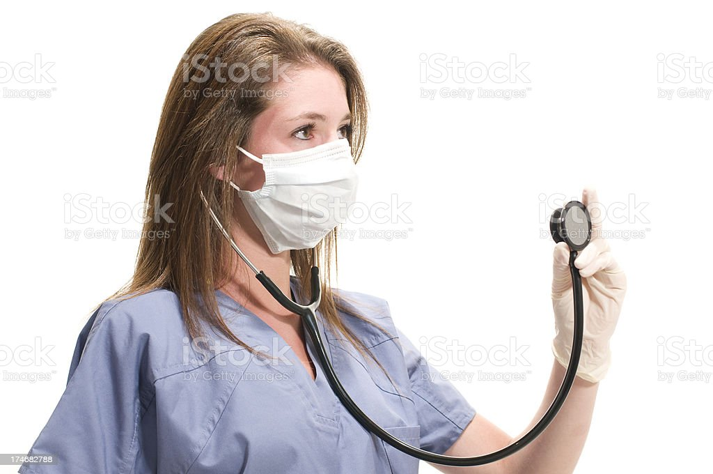 Healthcare worker with a mask and stethoscope royalty-free stock photo