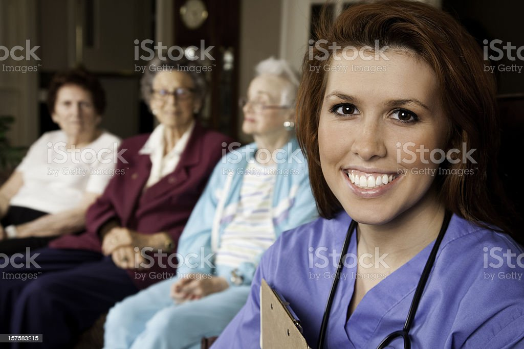 Healthcare Worker with Group of Senior Adult Patients royalty-free stock photo