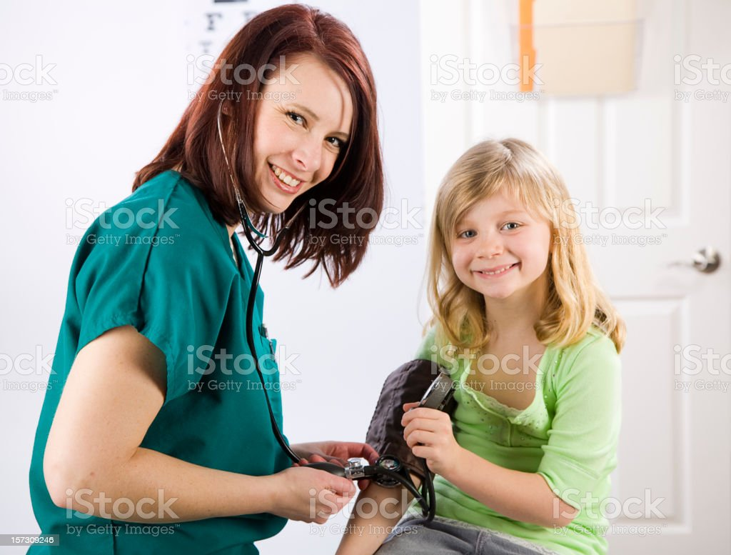 Healthcare Worker with Young Girl Patient royalty-free stock photo