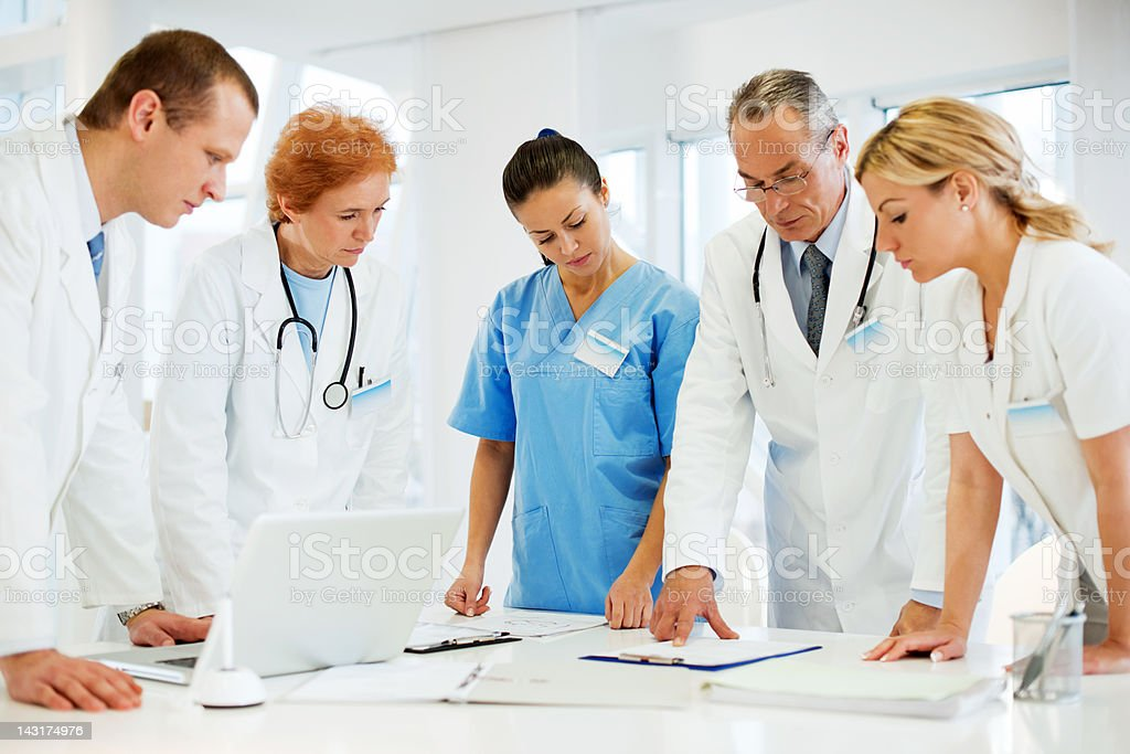 Healthcare Workers in a Doctor's Office stock photo
