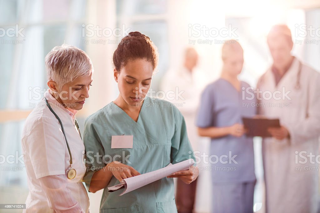Healthcare workers reading medical documents in the hospital. stock photo