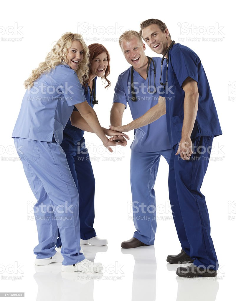 Healthcare workers stacking hands together royalty-free stock photo