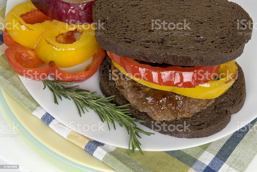 healthful hamburger on pumpernickel bread with grilled peppers royalty-free stock photo