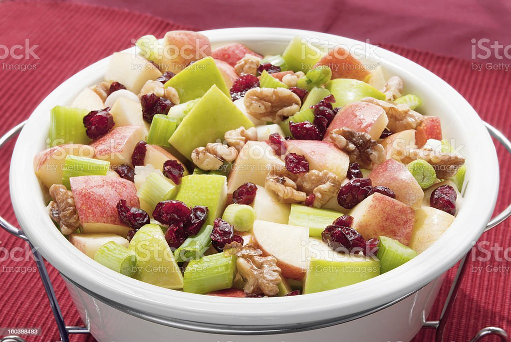healthful waldorf salad prepared with apples and fruits red background royalty-free stock photo