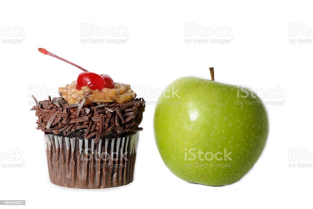 Healthier eating concept: Cupcake vs Apple stock photo