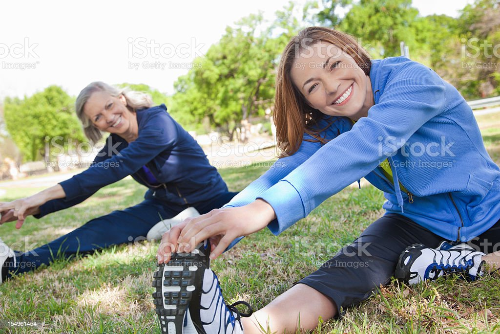 Healthy Active Women Stretching Legs Before Exercise royalty-free stock photo