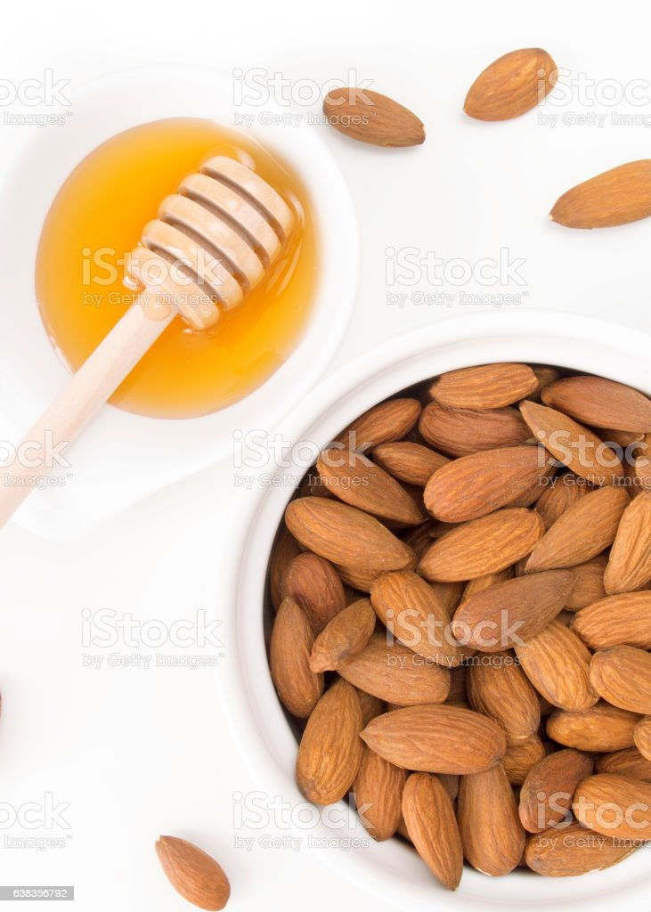 Healthy almonds and honey on white background stock photo