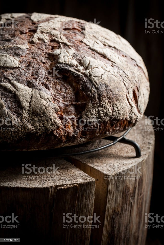Healthy and fresh bread with whole grains on dark table stock photo