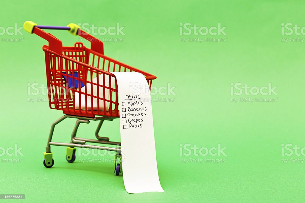 Healthy and fruitful: shopping list on tiny trolley headed Fruit royalty-free stock photo
