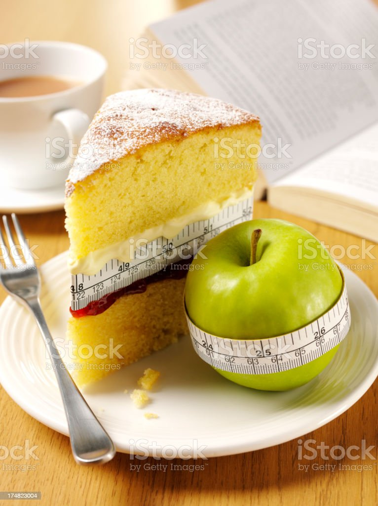 Healthy and Unhealthy Cake with a Apple for Afternoon Tea stock photo