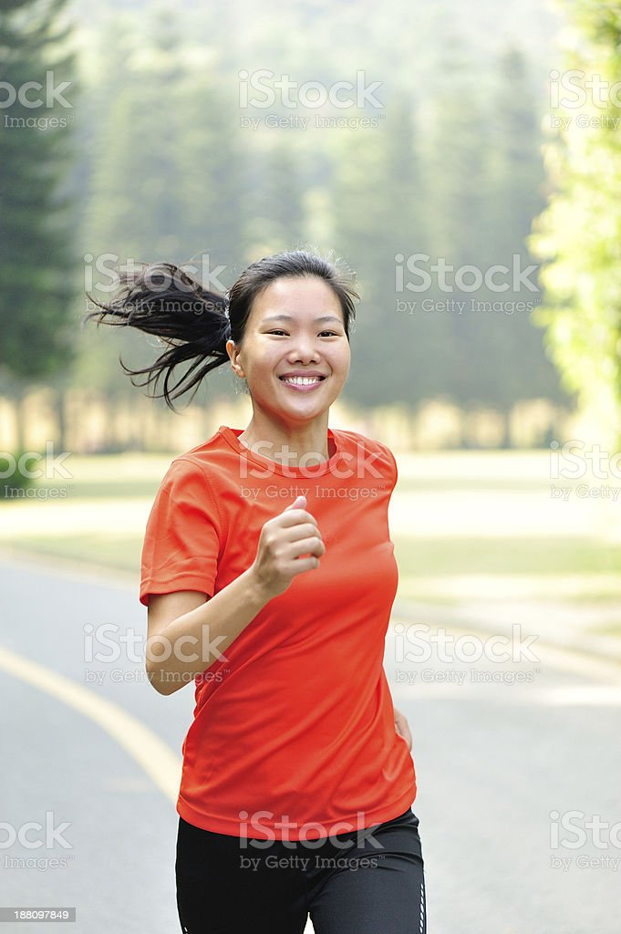 healthy asian woman running in park royalty-free stock photo