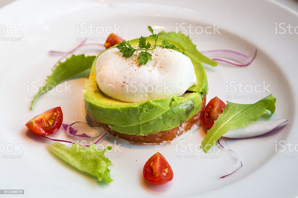 Healthy avocado poached eggs breakfast set stock photo