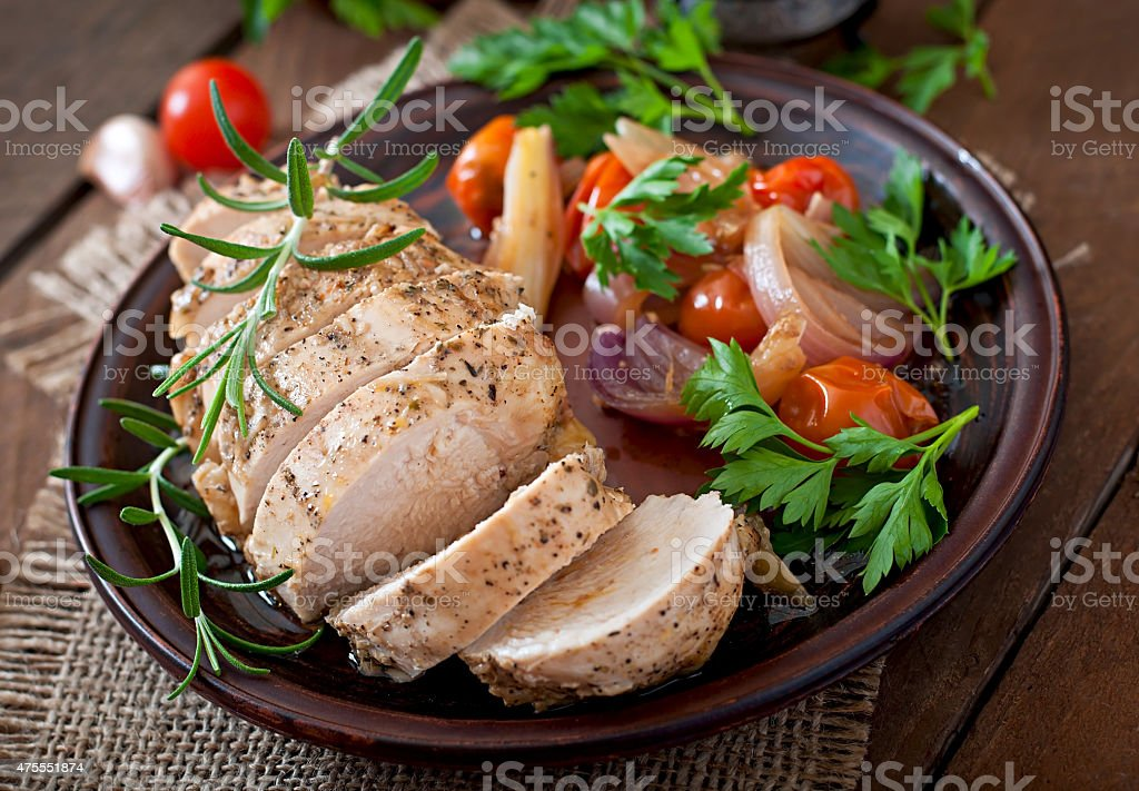 healthy baked chicken breast with vegetables stock photo