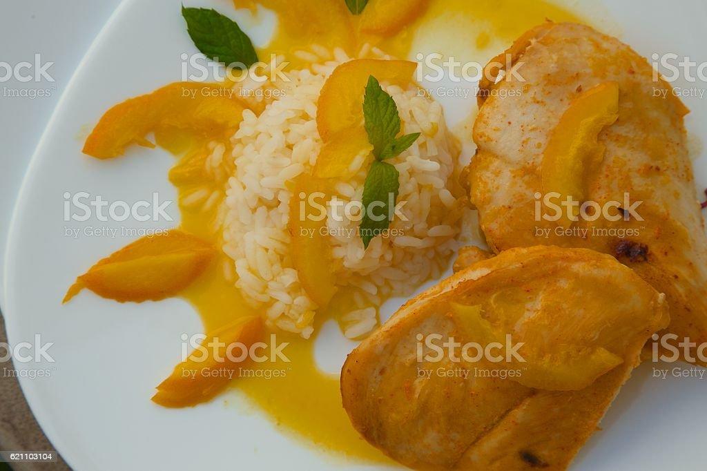 Healthy balanced lunch -chicken rice in orange sauce stock photo
