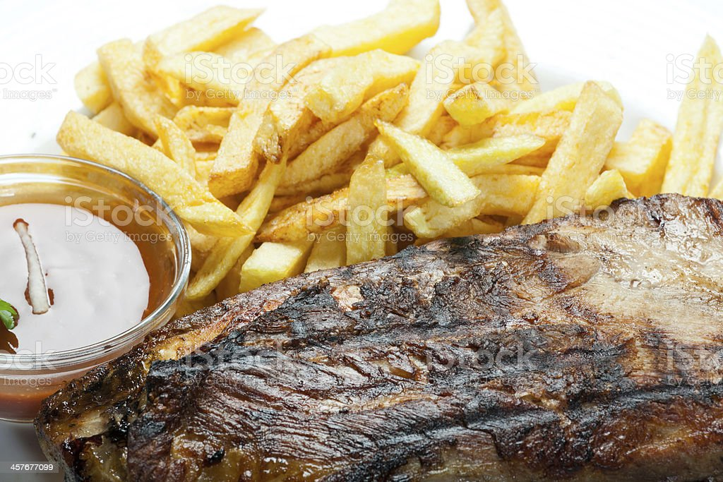 Healthy Barbecue Slow Cooker Ribs and Potatoes fries royalty-free stock photo