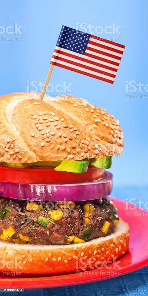 Healthy Beef Hamburger with American flag stock photo